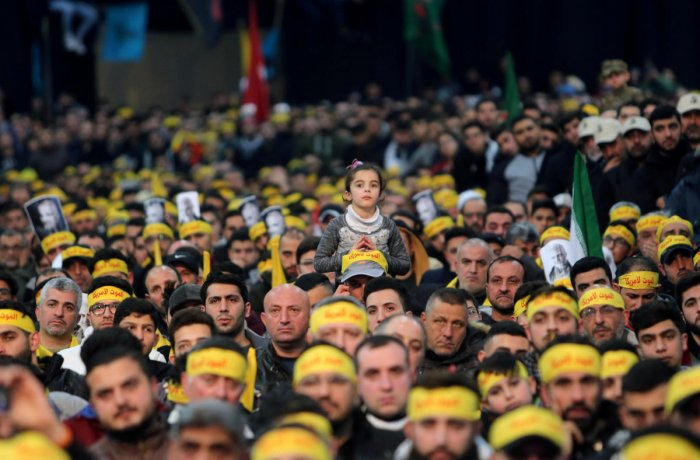FILE PHOTO: Lebanon's Hezbollah supporters attend a funeral ceremony rally to mourn Qassem Soleimani, head of the elite Quds Force, who was killed in an air strike at Baghdad airport, in Beirut's suburbs. Reuters