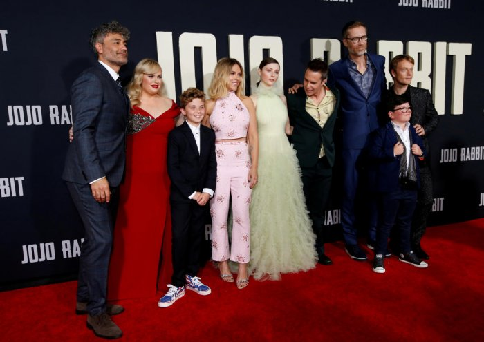 """Director and cast member Taika Waititi and fellow cast members Rebel Wilson, Scarlett Johansson, Thomasin McKenzie, Sam Rockwell, Stephen Merchant, Archie Yates, and Alfie Allen attend the premiere for the movie """"Jojo Rabbit"""" in Los Angeles. Reuters file photo"""