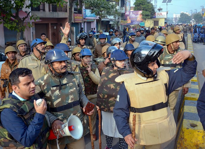 Police personnel attempt to control a protest against the Citizenship (Amendment) Act (CAA), in Muzaffarnagar. (PTI Photo)