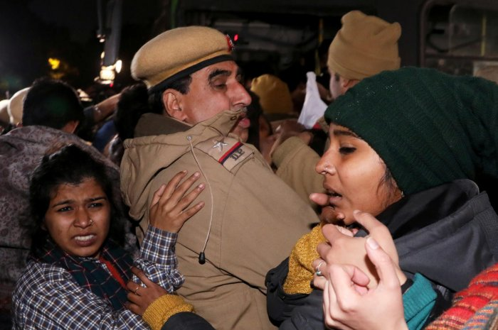 Protesters scuffle with police officers as they detain demonstrators during a protest march against the attacks on the students of Jawaharlal Nehru University (JNU), in New Delhi. (Credit: Reuters)
