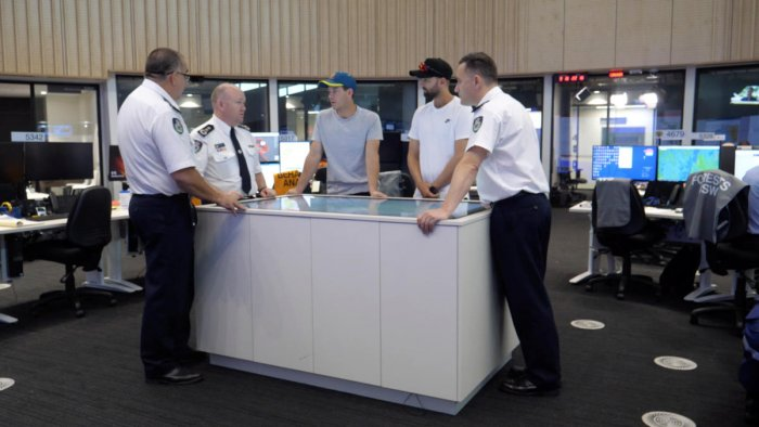 Australia cricketers Tim Paine and Nathan Lyon visit Fire Department Control Centre in Southern Highlands. Photo:Reuters/Cricket Australia