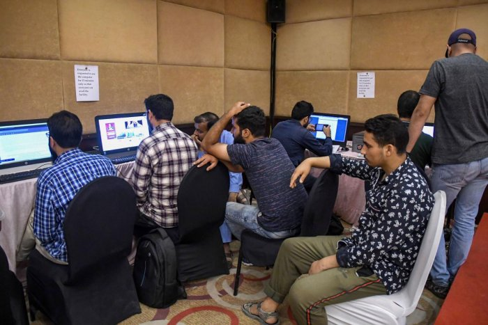 Journalists wait for their turn to access the internet at a temporary media centre set up by the government, on the 42nd day following the abrogation of Article 370, in Srinagar, Sunday, Sept. 15, 2019. Internet services remained suspended across all platforms, while landline across the valley were functional, voice calls on mobile devices were working only in Kupwara and Handwara police districts of north Kashmir. (PTI Photo