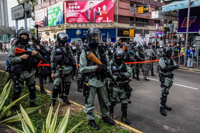 Riot police watch as pro-democracy protesters (not in picture) march along a street during a demonstration against parallel trading in Sheung Shui in Hong Kong on January 5, 2020. (AFP Photo)