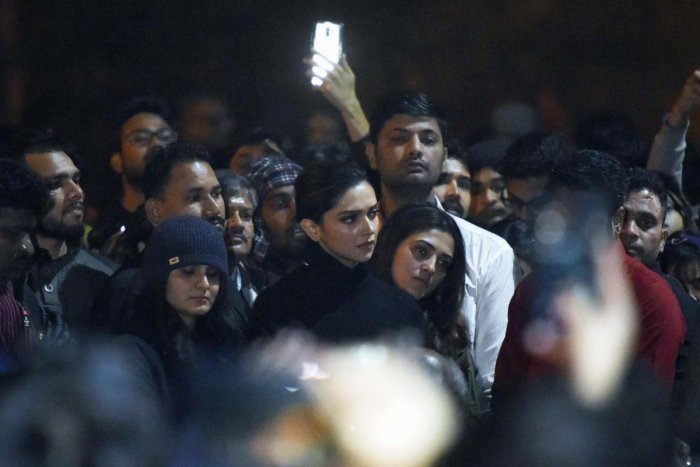 In this photo taken on January 7, 2020, Bollywood actress Deepika Padukone (C) visits students protesting at Jawaharlal Nehru University (JNU) against a recent attack at JNU on students and teachers in New Delhi. - Protests have been held across India aft