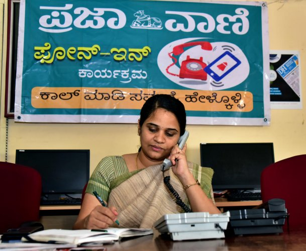 Deputy Commissioner Sindhu B Rupesh speaks to a caller during the Prajavani-DH phone-in programme at the Prajavani-Deccan Herald office in Mangaluru on Thursday.