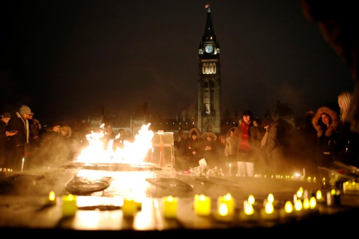 Hundreds attended a candle light vigil for the victims of Ukraine International Airlines flight PS-752 on Parliament Hill in Ottawa, Ontario, Canada January 9, 2020. (Reuters Photo)