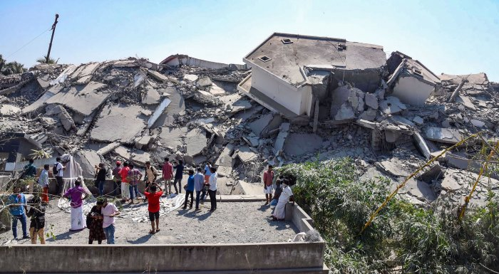 Debris are seen after a controlled implosion to demolish illegal apartments at Maradu in Kochi. (PTI Photo)