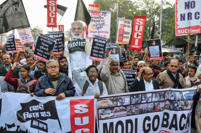 SUCI activists participate in a protest against arrival of PM Narendra Modi to the city over CAA, NRC and NPR and violence in JNU, in Kolkata. (Credit: PTI)