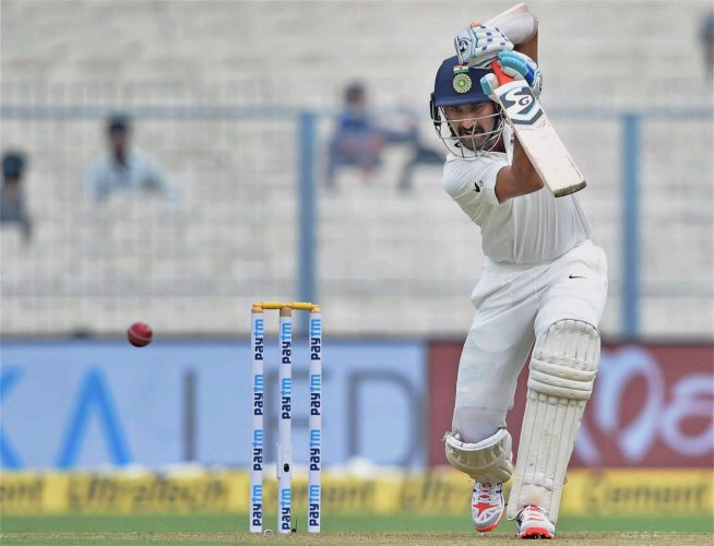 Cheteshwar Pujara slayed Karnataka's toothless attack with an unbeaten 162 on the opening day of their Ranji Trophy match on Saturday. PTI