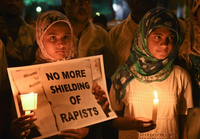 Girls during a candlelight vigil against the brutal rape and murder of 8-year-old Kathua girl Asifa and demanding for justice in Bengaluru on Saturday. (PTI Photo by Shailendra Bhoja)