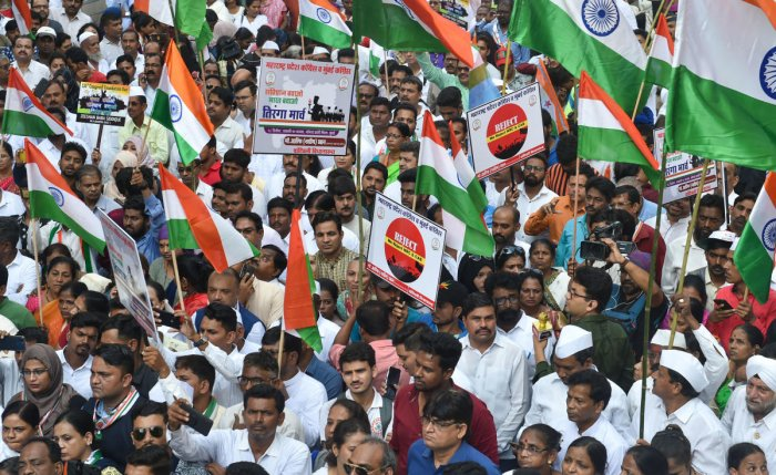 Congress party workers participate in a protest march 'Shanti March' to oppose NRC and CAA in Mumbai. (PTI Photo)