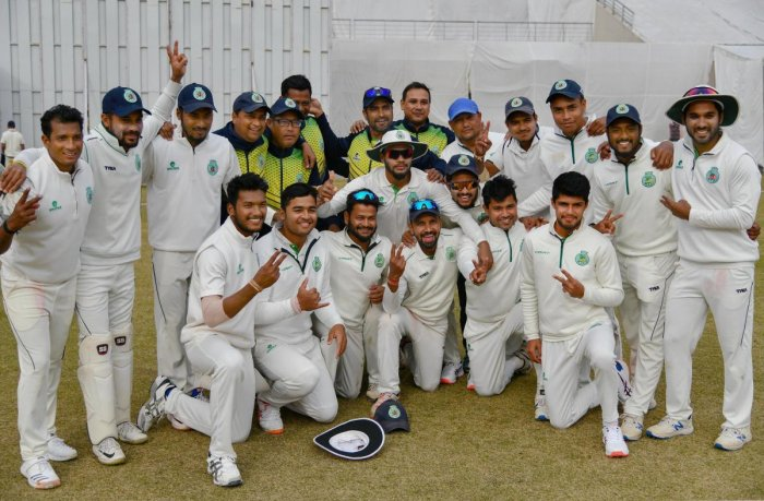 Members of Assam cricket team celebrate after their win against Uttarakhand by an innings and 82 runs, in Dehradun. (PTI Photo)
