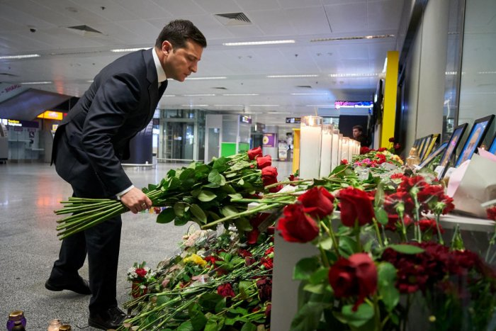 Ukrainian President Volodymyr Zelenskiy lays flowers to commemorate victims of the Ukraine International Airlines Boeing 737-800 plane crash, at a memorial in Boryspil International Airport. (Reuters Photo)