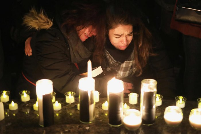 Mourners attend an outdoor vigil for the victims of a Ukrainian passenger jet which crashed in Iran, in Toronto, Canada. Iran admitted to unintentionally shooting down the jet. (REUTERS Photo)