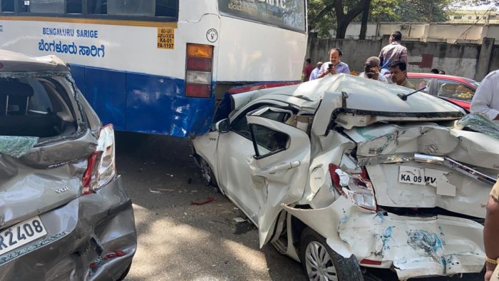 Mangled remains of the cars damaged in the accident in Jayanagar on Friday. DH Photo