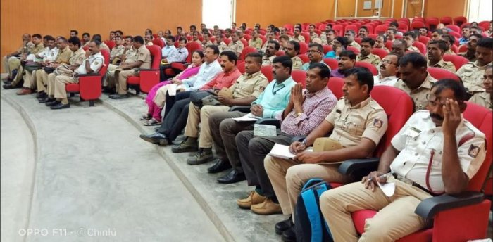 Officials of Police and Transport departments participate in the training programme on Motor Vehicle Act, 1998, at the Office of Superintendent of Police in Mysuru on Saturday.