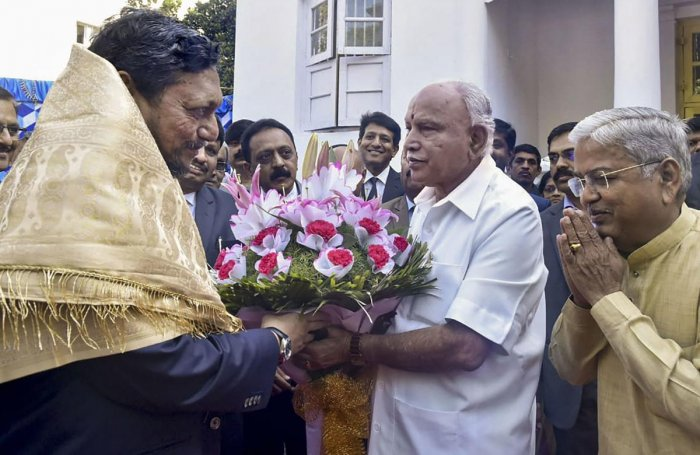 Karnataka Chief Minister BS Yediyurappa with Chief Justice of India S A Bobde during the meeting, in Bengaluru. (PTI Photo)