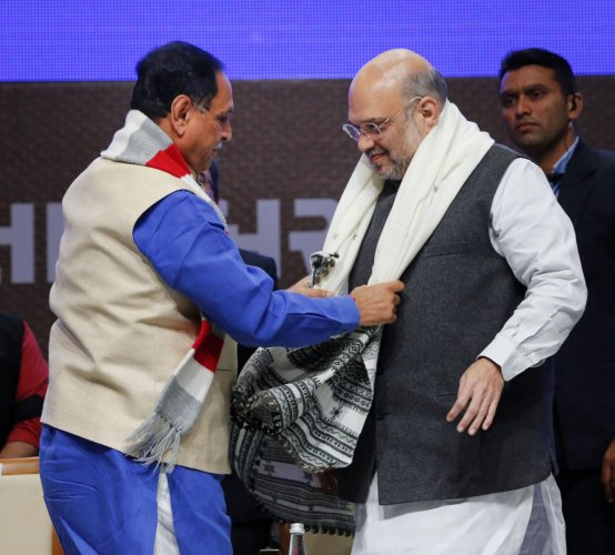 Gujarat Chief Minister Vijay Rupani welcomes Union Home Minister Amit Shah during an event to inaugurate various projects of Gujarat police. (Credit: PTI)