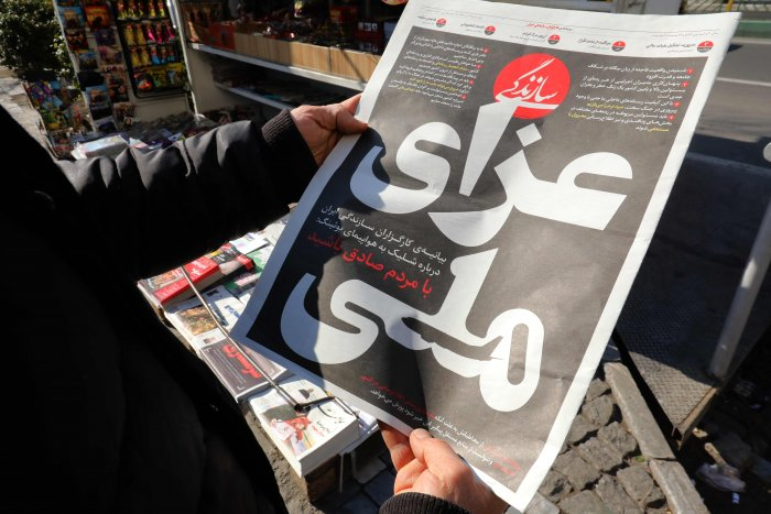 "An Iranian man checks a local newspaper headline that reads ""National Mourning"" refering to the downed Ukranian jetliner outside the capital Tehran last week, in front of a news stand in the Islamic republic's capital Tehran. (AFP Photo)"