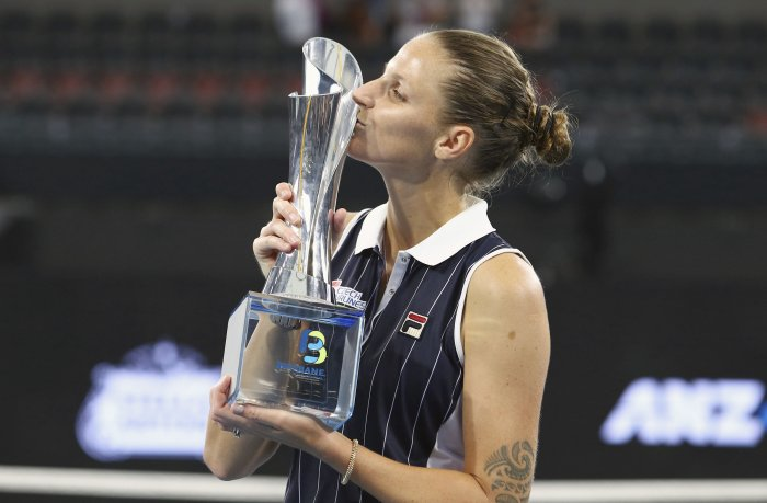 Karolina Pliskova of the Czech Republic poses with the trophy after she won her final match against Madison Keys of the United States 6-4, 4-6, 7-5, at the Brisbane International tennis tournament in Brisbane, Australia. (AP Photo)