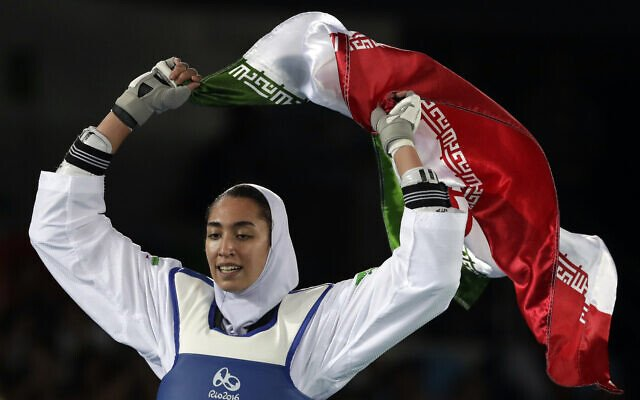 Kimia Alizadeh of Iran celebrates after winning the bronze medal in a women's Taekwondo 57-kg competition at the 2016 Summer Olympics in Rio de Janeiro, Brazil, Thursday, Aug. 18, 2016. (AP File Photo)