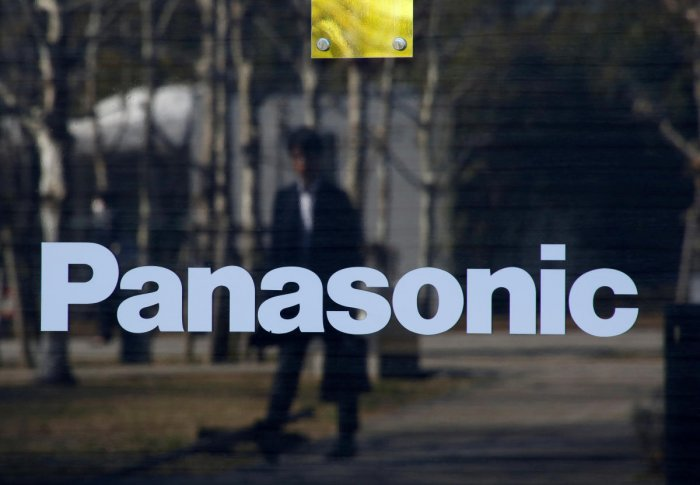 A man is reflected on Panasonic Corp's logo at Panasonic Center in Tokyo, Japan, February 2, 2017. (Reuters Photo)