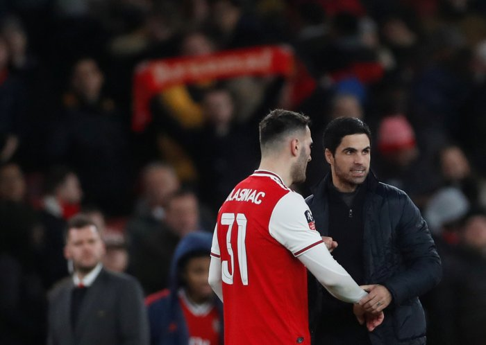 Arsenal manager Mikel Arteta celebrates with Sead Kolasinac after the match. (Reuters Photo)