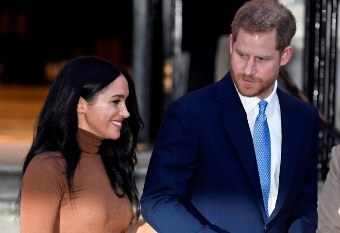 Britain's Prince Harry and his wife, Meghan. (AFP Photo)