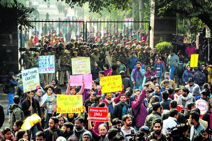 JNU students gather at the entrance gate of the Jawahar Lal University before leaving for their protest march. (PTI photo)