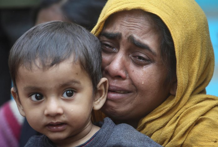 File Reuters picture of a Rohingya Muslim woman crying holding her daughter