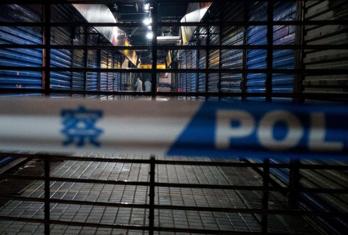 Members of staff of the Wuhan Hygiene Emergency Response Team conduct searches on the closed Huanan Seafood Wholesale Market in the city of Wuhan, in the Hubei Province of China. AFP