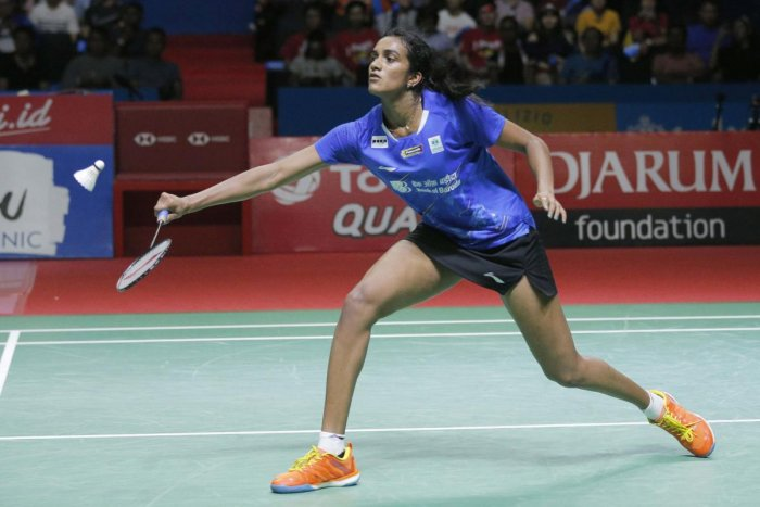 P.V. Sindhu of India competes against Akane Yamaguchi of Japan during their women's singles final match at Indonesia Open badminton championship at Istora Stadium in Jakarta, Indonesia. Photo: PTI