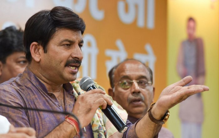 BJP MPs Manoj Tiwari and Vijay Goel at a press conference in New Delhi. PTI Photo