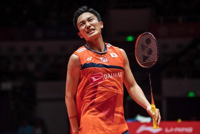 Kento Momota of Japan reacts during his men's singles final match against Anthony Sinisuka Ginting of Indonesia at the BWF World Tour Finals badminton tournament. (AFP PHOTO)