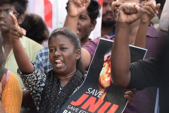 Members of Democratic Youth Federation of India (DYFI) along with Student Federation of Indian (SFI) hold placards and shout slogans during a protest against an attack on the students and teachers at the Jawaharlal Nehru University (JNU) campus in New Del