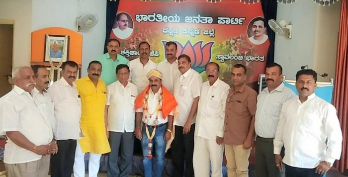 Paleyanda Robin Devaiah being felicitated by BJP leaders, after he was appointed the president of Kodagu district BJP, at Dakshina Kannada district BJP office in Mangaluru, on Sunday. DH Photo