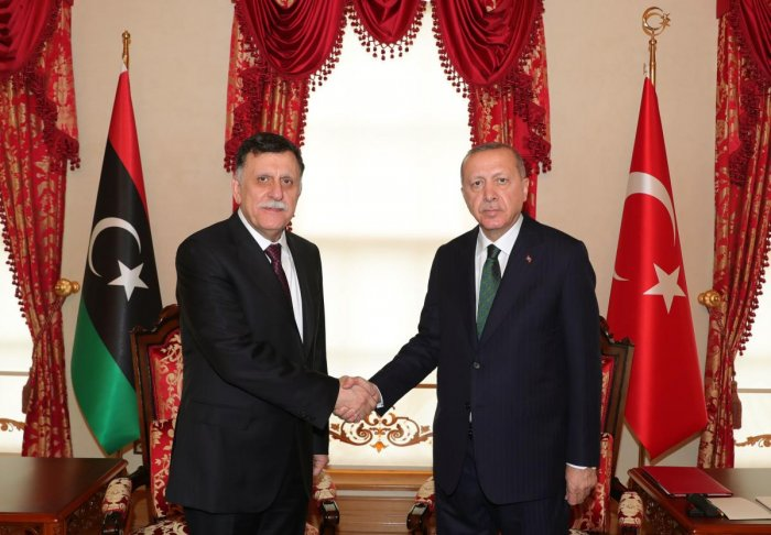 Turkey President Recep Tayyip Erdogan (R) shakes hand with the head of Libya's Government of National Accord (GNA) Fayez al-Sarraj (L) at the start of their meeting in Istanbul. Photo Reuters