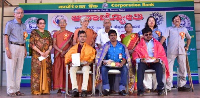 Visually challenged youth Gururaj, Nithyananda and Pradeep, who had topped the Mangalore University's BSW examinations, were felicitated during the 22nd 'Vishishtarigagi Vishishta Mela' organised at Canara High School Grounds (main) in Dongerkeri on Sunda