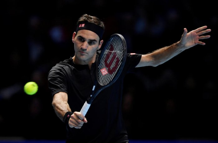 Switzerland's Roger Federer in action during his group stage match against Serbia's Novak Djokovic (Reuters Photo)