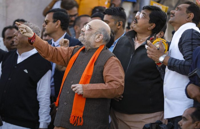 Union Home Minister Amit Shah flies a kite during the kite flying festival 'Uttarayan', in Ahmedabad. (Credit: PTI)