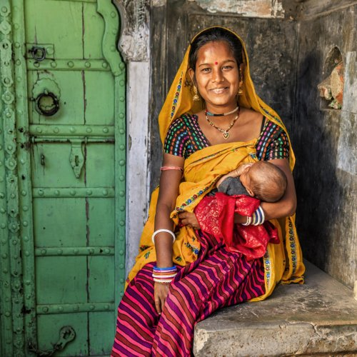 Young Indian mother breastfeeding her newborn child, Amber near Jaipur, Rajasthan, India.