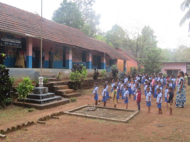 Children during the morning assembly at Government Higher Primary School at Kookrabettu in Belthangady Taluk.