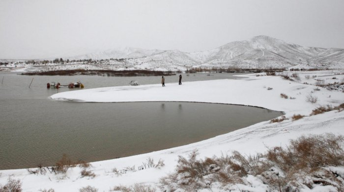 The snow-covered Hanna Lake after a snowfall on the outskirts of Quetta, Pakistan. (Reuters Photo)