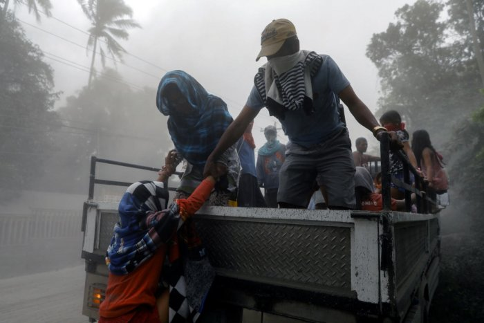 Residents living near the erupting Taal Volcano evacuate from Lemery, Batangas, Philippines, January 13, 2020.
