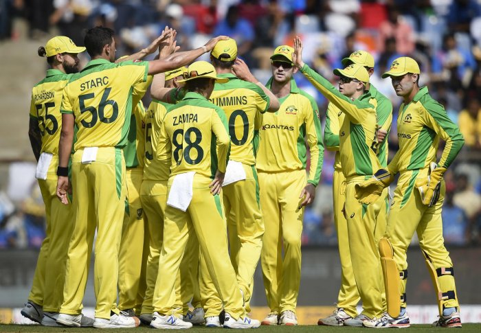Australian bowler Mitchell Starc along with his teammates celebrates the wicket of Rohit Sharma during the first one day international (ODI) cricket match between India and Australia, at the Wankhede Stadium in Mumbai, Tuesday, Jan. 14, 2020. (PTI Photo)