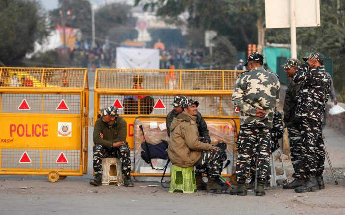 Central Reserve Police Force personnel are pictured next to a barricade at a protest site, in Shaheen Bagh, area of New Delhi