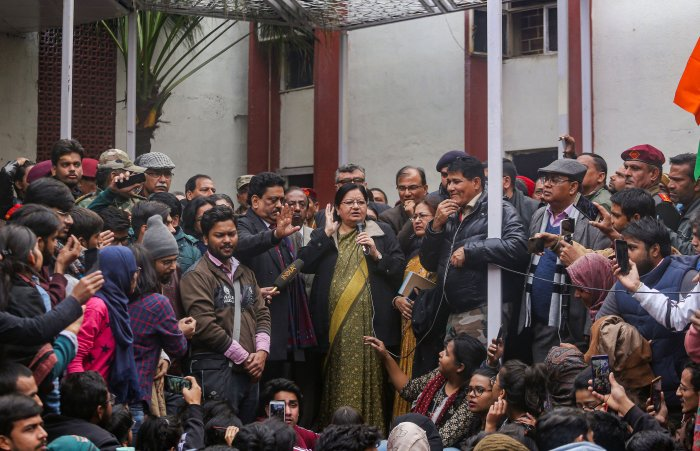 """Jamia Millia Islamia VC Najma Akhtar addresses protesting students who were demanding registration of a FIR against the """"police brutality"""" on campus last month, at Jamia campus in New Delhi, Monday, Jan. 13, 2020. (PTI Photo)"""