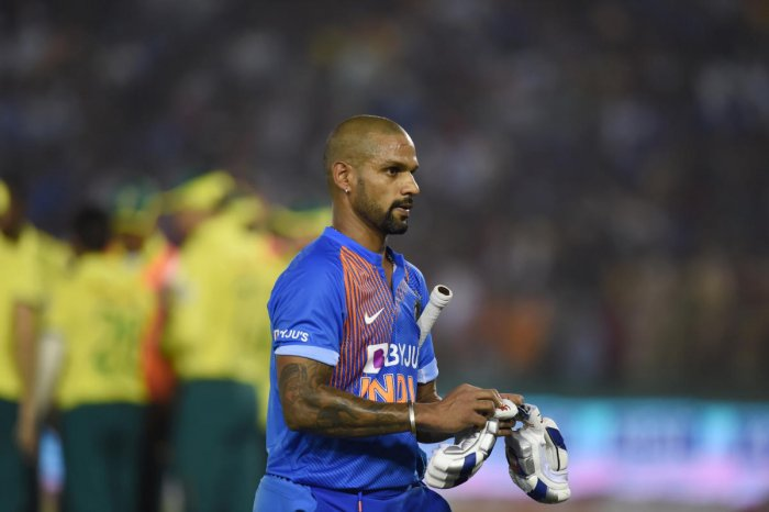 India's Shikhar Dhawan walks off the pitch after being dismissed. (PTI PHOTO)