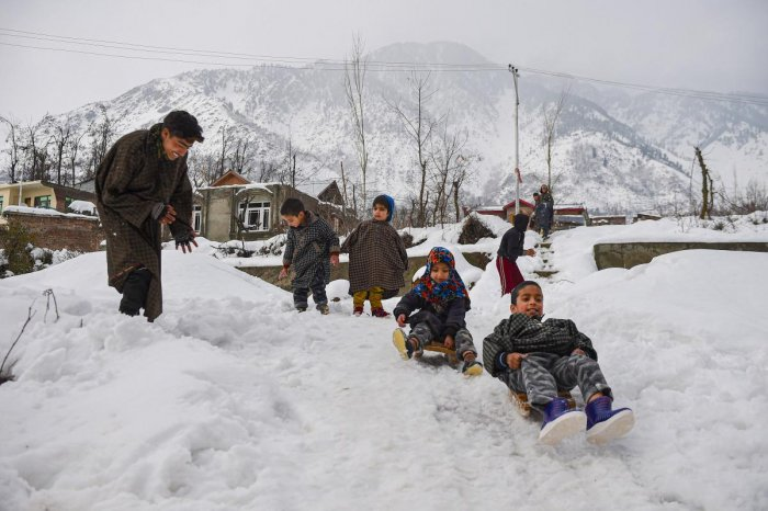 Children play with snow balls, after heavy snowfall on the outskirts of Srinagar, Tuesday, Jan. 14, 2020. (PTI Photo/S. Irfan)