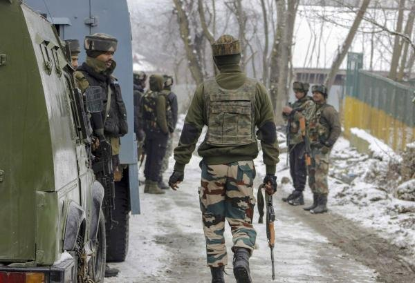 Army personnel take positions near a house where militants were hiding, during a cordon-and-search operation, at Gulshanpora in Tral area of South Kashmir, Sunday, Jan. 12, 2020. (PTI Photo)